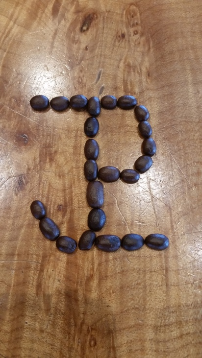 Our logo in coffee beans.