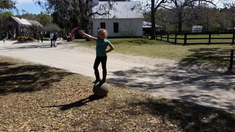 Balancing on a boulder.