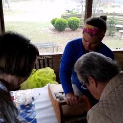 Helping to tease fresh wool.